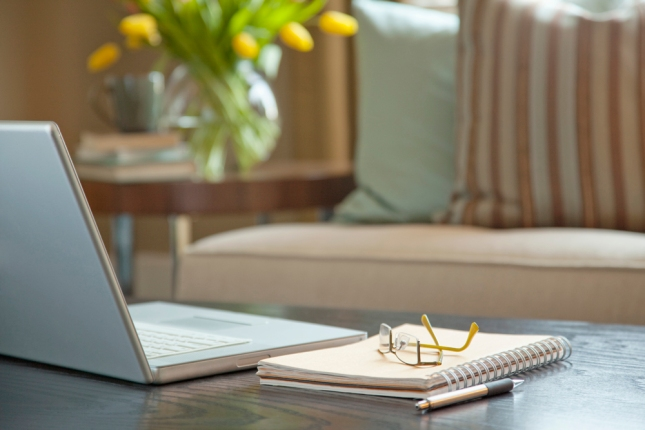 Laptop on coffee table --- Image by © Kate Kunz/Corbis